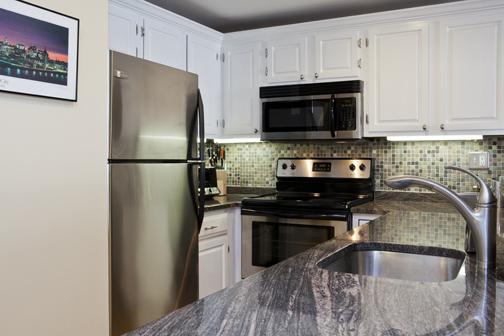 Steel Appliances In The Kitchen Of A Condo Near Harvard University