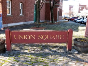 You'll walk out your door into the heart of Union Square in Somerville