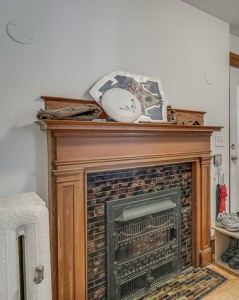 The lovely vestibule on the first floor has a fireplace and stained glass windows.